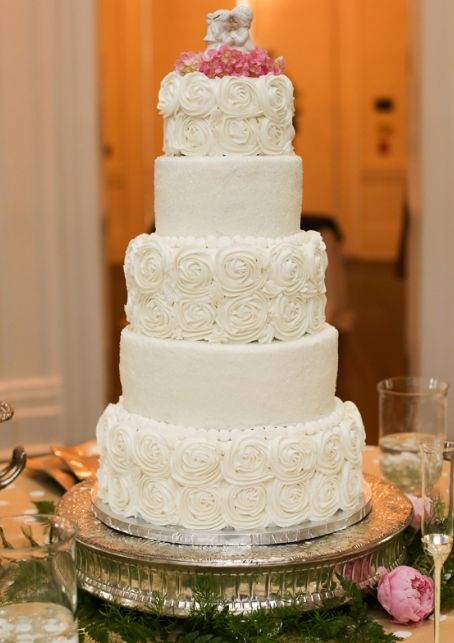 "Modern classic wedding cake. White with contemporary ""ruffle"" roses every second tier."