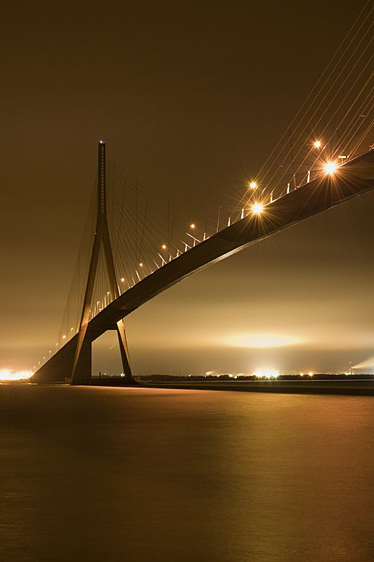 Pont de Normandie - World's longest multi-span cable-stayed bridge (1995) . . . Spans the river Seine linking Le Havre to Honfleur in Normandy, northern France.  856 Meters, 2,808 Feet.