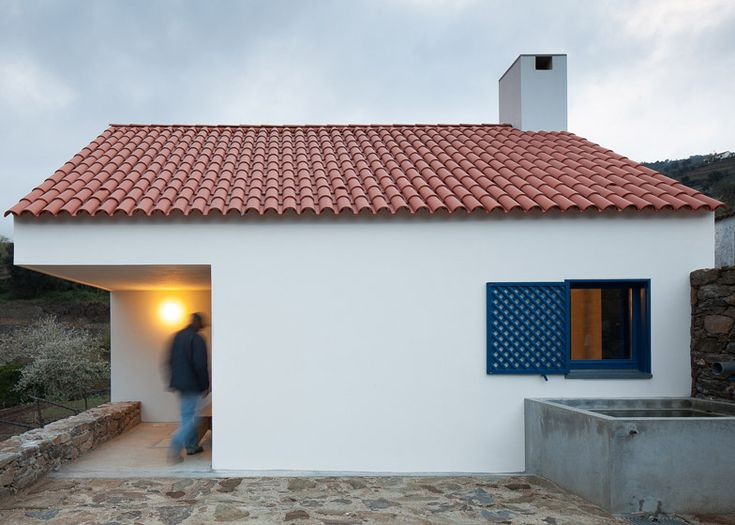 Small Portuguese house designed to integrate with the traditional farmhouses nearby.