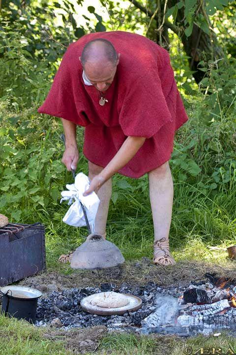 Roman military bread making. Clibanus in use.