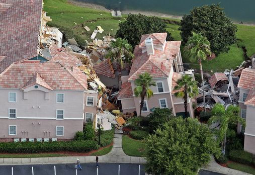 Aerial view Monday after a sinkhole swallowed two buildings at Summer Bay Resort late Sunday night.