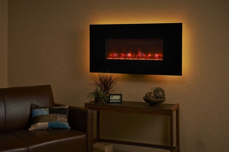 Wall Mount Electric Fireplace for Save Space - http://www.joninewman.com/wall-mount-electric-fireplace-for-save-space/ : #FireplaceFirepit Wall mount electric fireplace – Wall Mount Fireplaces save space and provide an interesting focal point for a room. Wall mounting electric fireplaces use a standard two-pin cable to connect it to an electrical outlet. Wall mount fireplaces are 100 percent efficient because they convert...