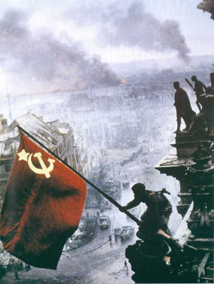 Moment in History: World War II in color. Russian military raising Soviet flag after the Americans and Soviets conquered Berlin and defeated Hitler.