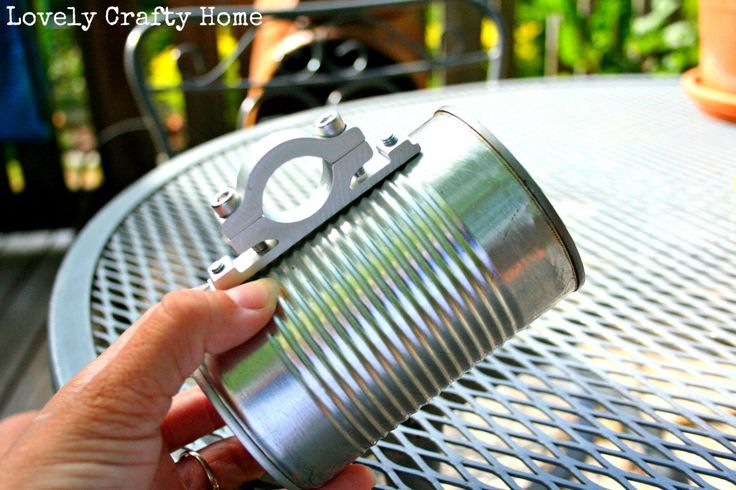 Make your own bike cup holder using an empty can. Decoupage with images for extra flair.