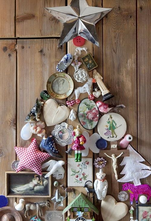 I love the idea of this found object Christmas tree!  Imagine taking bits and pieces of things you have collected over the   years, mementos or other small objects that hold meaning to you, and   arranging them into a holiday assemblage...