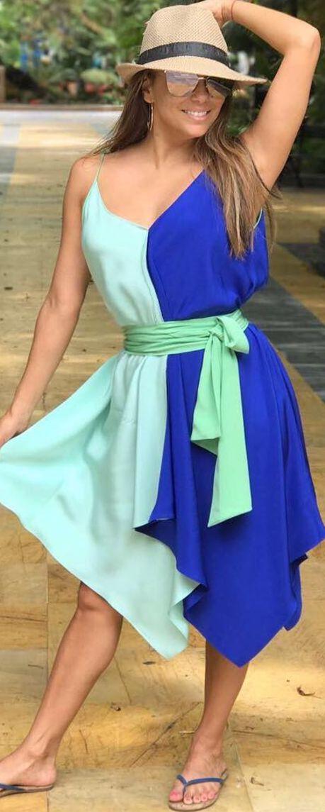 Who made  Eva Longoria's blue dress, flip flops, gold sunglasses, and tan hat?