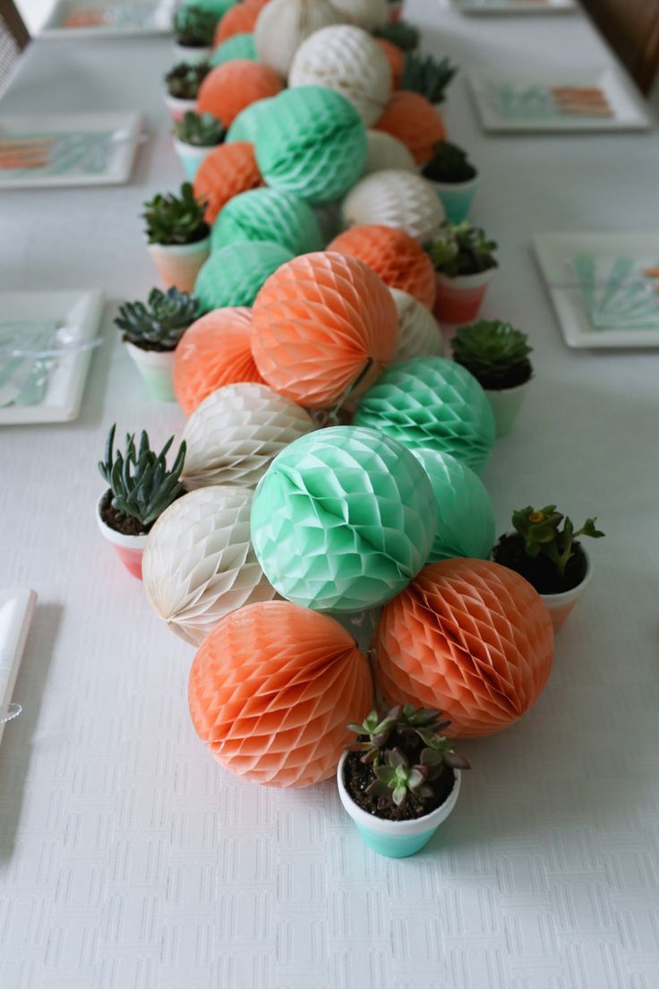 Mint and coral baby shower. Decorations, favorite party supply shops and craft and DIY tutorials. www.thedempsterlogbook.com