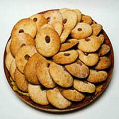 La ricetta degli 'nzuddi, biscotti tipici della pasticceria siciliana catanese a base di mandorle tritate preparati per la commemorazione dei defunti.