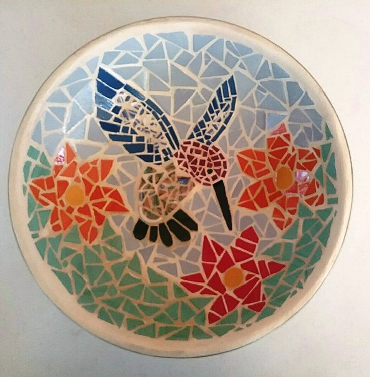 A mosaic hummingbird bowl. Made for my friend Sue. A much loved 50th birthday gift made from an old wok.