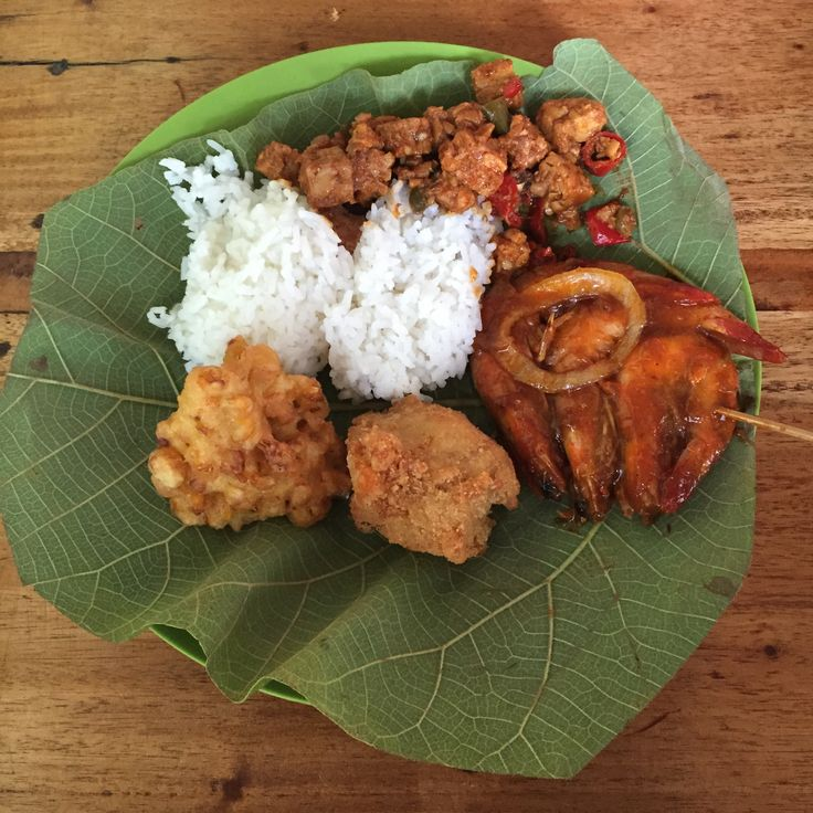 """Nasi Jamblang or Sega jamblang (Rice jamblang in English) is a typical food of Cirebon, West Java. """"Jamblang"""" comes from the name of the region to the west of the city of Cirebon, home of the food vendors. Characteristic of these foods is the use of teak as a pack of rice leaves. The dish is served via a buffet."""