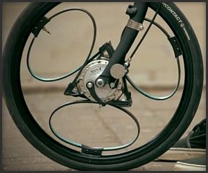 Loopwheels are unusual 20″ bicycle wheels with built-in suspension in the form of flexible carbon composite springs. The wheels still work with conventional hub brakes and gears.
