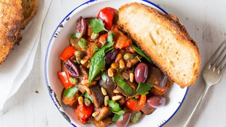 Caponata is a traditional Sicilian eggplant stew. It's really simple to make, it's packed with different veggies, herbs and spices and it's full of flavor. This wonderful dish is 100% vegan and super delicious! #vegan #recipes #veganfood #caponata #italian #stew #veggies #dinner
