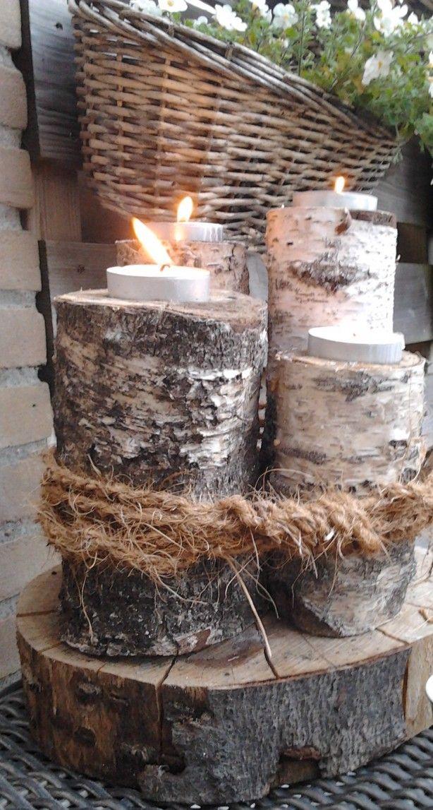 berkenboom stammetjes ombinden met jute touw, gat in bovenzijde maken kaarsjes erin... en klaar!!!