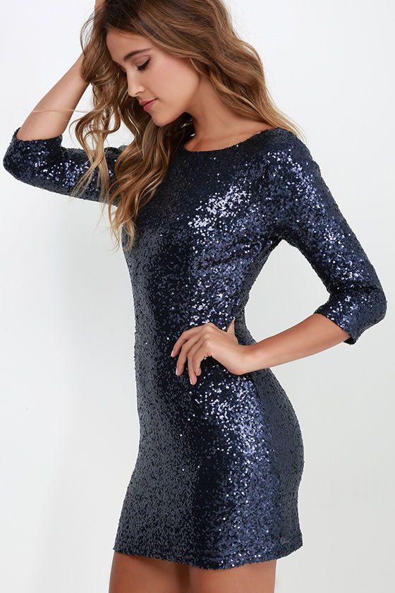 With your shining personality and style in spades, it's almost like the Delightful Ways Navy Blue Sequin Dress was made just for you! This woven poly dress is covered with beautiful shining navy blue sequins, for a classy modification. The rounded neckline has a scooping back and three-quarter sleeves, with princess seams starting on the fitted bodice and continuing down the bodycon skirt. Hidden back zipper/clasp.