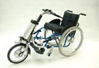 """Firefly wheelchair attachment to turn the chair into a scooter! It adds to accessibility! Rollick sells and delivers manual and electric powered attachable hand bikes, electric wheelchairs travel, hevelaandrijving a wheelchair all Rio Mobility, during cycling of the Flaring Petra """"runner"""" bike. We supply both to dealers and individuals. Check out the video at link."""