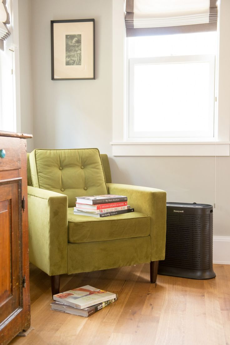 There's nothing like a bright green velvet chair to sit back and relax. The living room air stays clean with the Honeywell True HEPA Whole Room Air Purifier. Sponsored.
