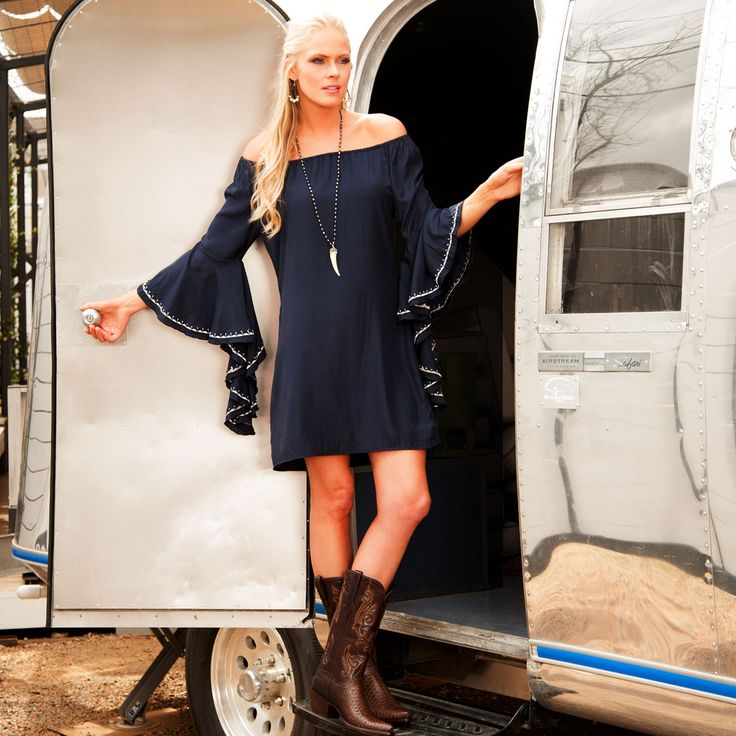 Off the shoulder with flowy sleeves - this navy Union of Angels dress is perfectly paired with cowgirl boots!