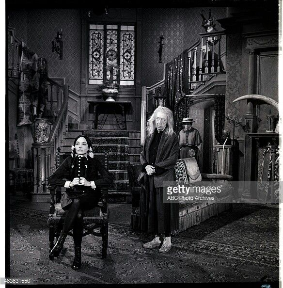 Carolyn jones as morticia and blossom rock as grandmama in for The addams family living room