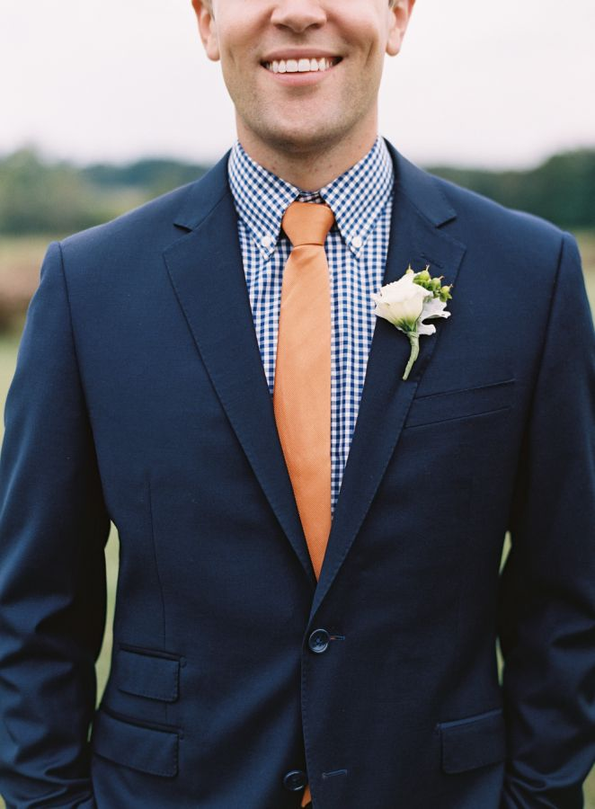 A peach tie and navy blue suit: http://www.stylemepretty.com/2015/12/31/charming-southern-merry-hill-farm-wedding/ | Photography: Graham Terhune - http://www.grahamterhune.com/