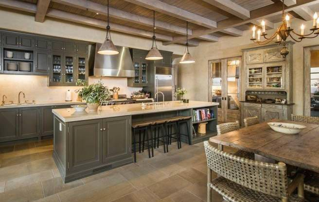 Lady Gaga's new $23 million Malibu mansion has a European-inspired kitchen with exposed beams and beautiful rustic details.