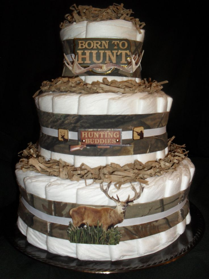 Hunting Camo Theme Diapercake. great for a baby shower for a boy or girl everybody loves camo and its a cake that doesnt put more weight on ur hips :)