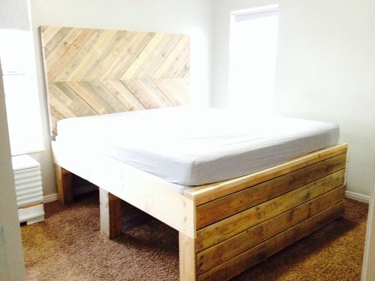 Pallet wood California king headboard and bed with covered box springs. Built high enough to store up to 12 totes underneath. Cool!