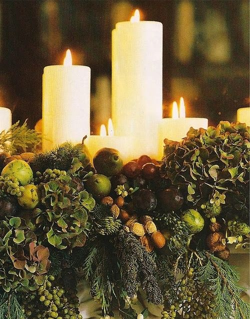 Rich tablescape with candles, evergreens, berries, antique hydrangeas, pears, apples and nuts....