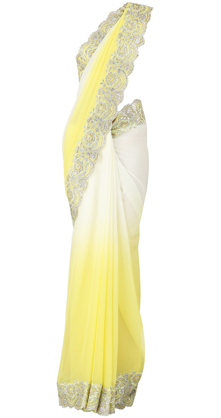 Ivory and lemon shaded chiffon sari with lemon yellow border and yellow blouse by SUNEET VARMA. Shop at https://www.perniaspopupshop.com/whats-new/suneet-varma-4182