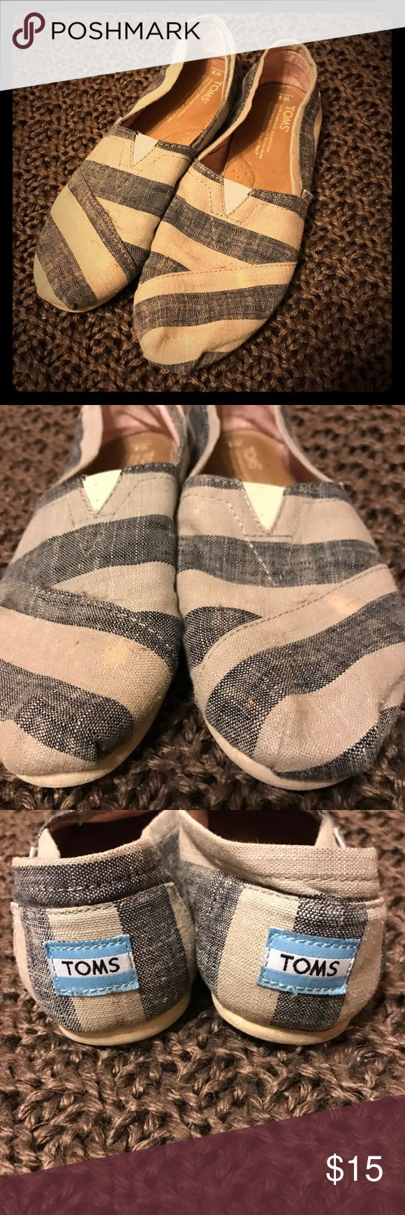 TOMS for Women TOMS for Women.. Stripped pattern.. Flaws: There is some faded bleach spots, shown in #2 picture. The spots aren't that noticeable as you can see.. No wear on the edges at the bottom, no wear on the toes, insides are still in very good clean condition.. Size 8 women's.. TOMS Shoes Flats & Loafers