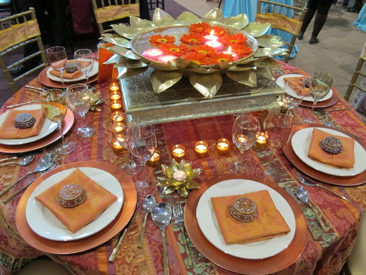This is a thai table setting, flowers such as orchids are put in ...