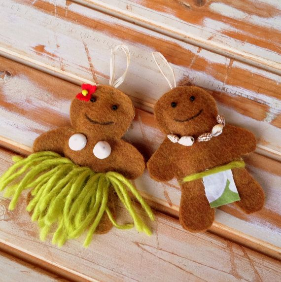 Hawaiian kine gingerbread ornaments for your Christmas tree. The wahine has a grass skirt and a puka shell bra. The kane has a Hawaiian print