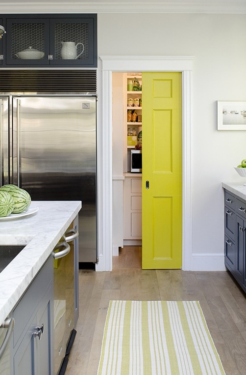Love these dark grey kitchen cabinets with white counters but with teal pocket pantry door!