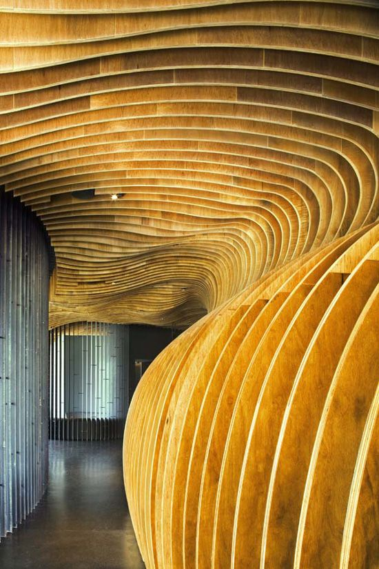 """""""Genexis Theater"""": Lined with parallel sheets of plywood, the lobby areas of this theater in Singapore provide acoustic dampening as well as a dramatic entrance to the award-winning stage; Fusionopolis complex, Singapore 