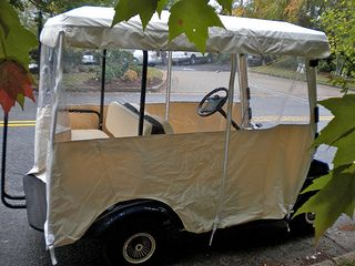 A universal Golf Cart Enclosure like this one keeps the rain and cold out.  Just slips over the top. The size you get is based on the length of the golf cart roof.