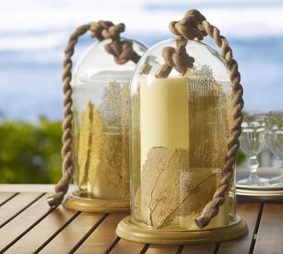 rope-handle-blown-glass-cloche: Capture a bit of summer under a cloche or glass bell jar. Explore these beautifully chic coastal cloche decor ideas for your home.