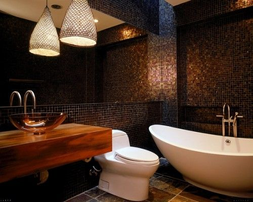 Dark, rich colors and plain toilet and tub, kind of a let down
