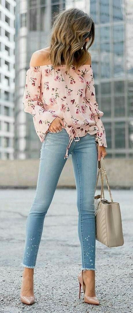 Pretty pink floral print off the shoulder blouse with denim jeans.