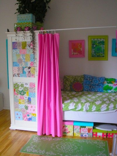This is EXACTLY what we need to do for the girls' room!! Lots of color, privacy for each of them. What a fabulous place to lounge and read a book!