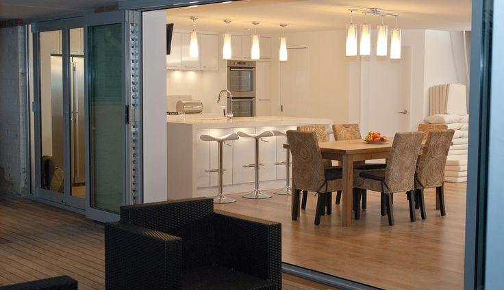 indoor / outdoor flow with basement renovation by refresh