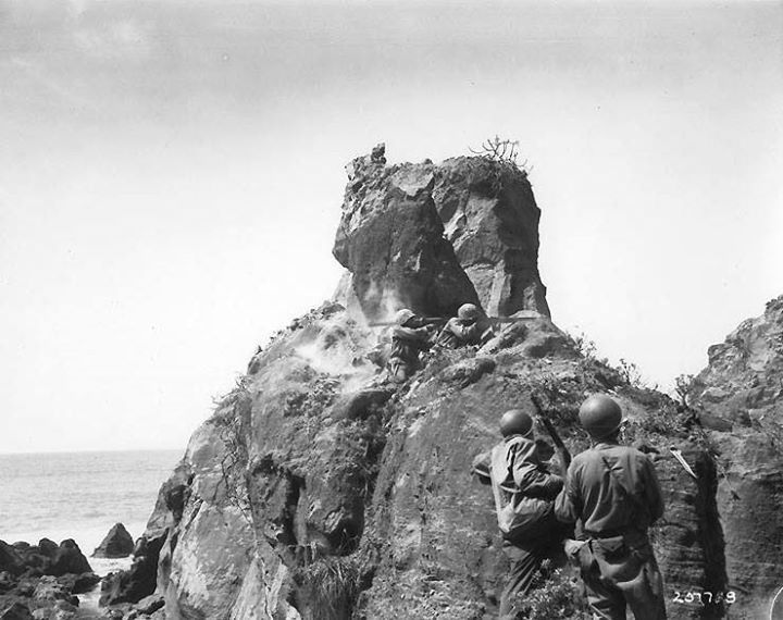Americans attacked Japanese snipers in a cave with bazooka and small arms northern coast of Iwo Jima during mop up operations 8 April 1945.