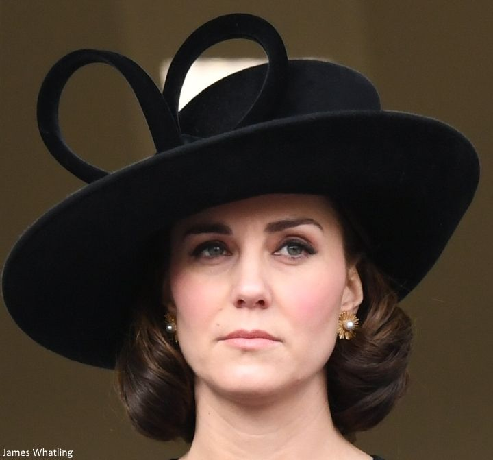 Kate brought back her wide brimmed black Philip Treacy hat. Duchess Kate