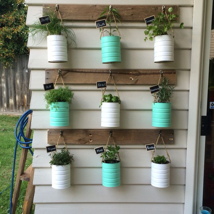 Formula Tins reused for our herb vertical garden. Supplies all from masters. Reused a wooden pallet and knocked off a few palings.