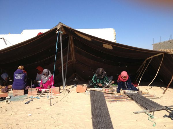 Bedouine women in the Sahara desert weaving a kira-cph collektion of runner rugs