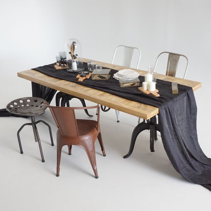 Sauvage Interiors chic industrial dining with selection of metal chairs and stool #industrialdining #pedestaldiningtable #parquetrytable