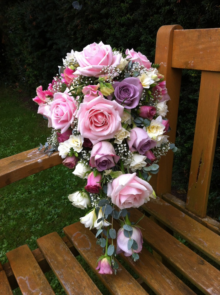 A teardrop bouquet with Sweet Avalanche roses...