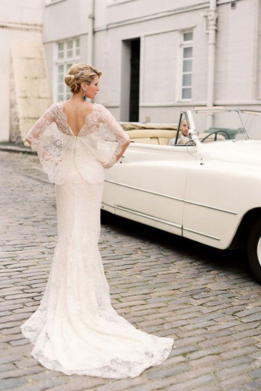Lace wedding dress with sleeves. Those sleeves look gorgeous!