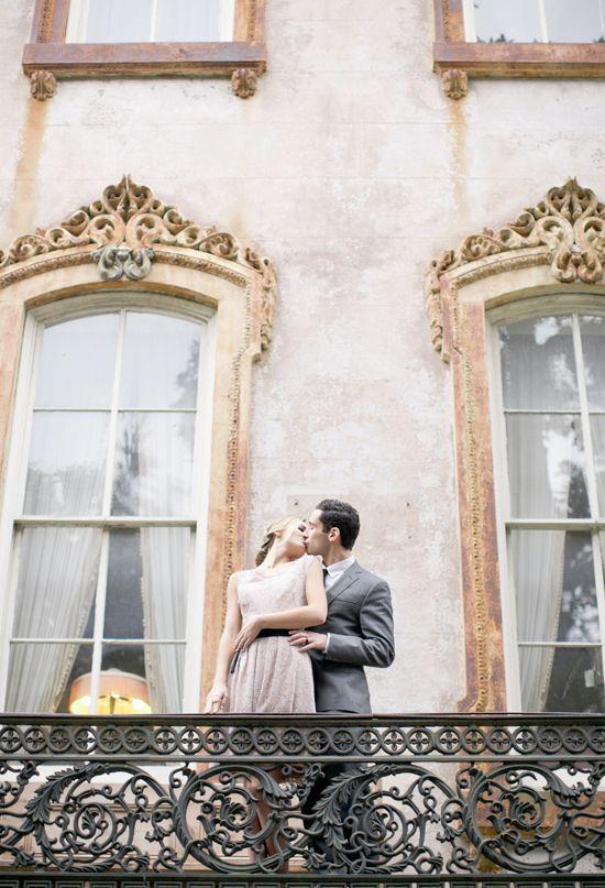 romantic balcony kiss | Photo by Jeremy Harwell | Hardee mansion on Monterey Square, Savannah GA
