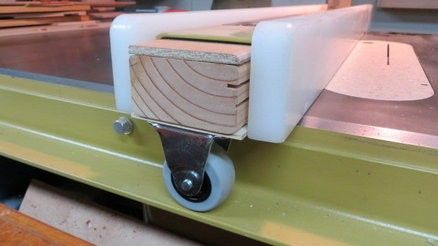 """Table Saw Fence Modification by jlb -- Homemade table saw fence modification consisting of a 3"""" caster wheel added to reduce friction. http://www.homemadetools.net/homemade-table-saw-fence-modification"""