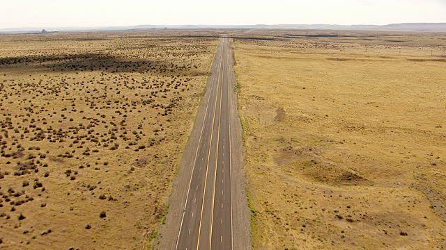 View of deserted highway in desert near Hanford site / Richland, Washington, United States