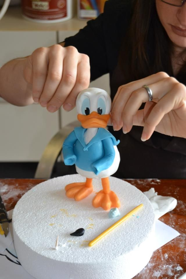 .donald duck. Okay, so it's cake decorating, but they gotta make these characters too, right?